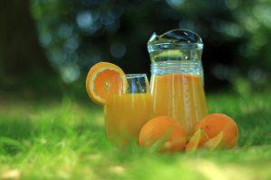 Orange juice in a glass pitcher